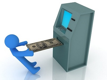 man depositing money into ATM